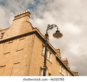 building with chimney and street lamp