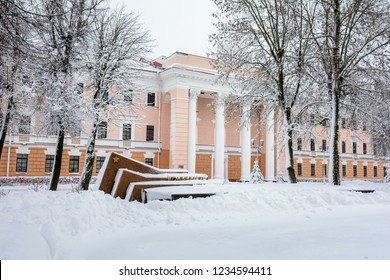 Building in the city center. Gomel. Belarus. 2. April. 2018. Administrative historical building in the city of Gomel. Near the monument to the heroes. Houses and streets are swept by snow