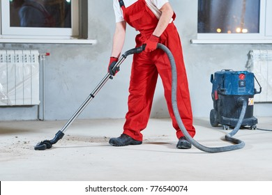 building cleaning service. dust removal with vacuum cleaner