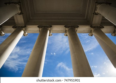 Building column on a government building with a beautiful blue sky.