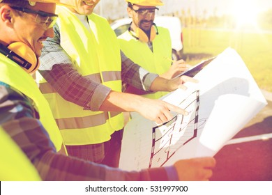 Construction worker pointing up stock photos images photography building construction development teamwork and people concept close up of builders high malvernweather Images