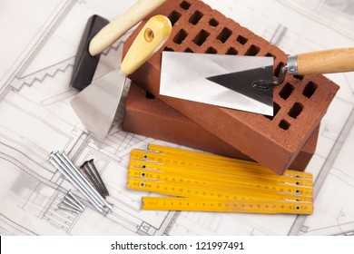 Building and construction equipment on blueprints