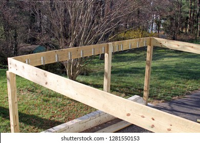Building construction frame of a house's new exterior wood deck being built in Springtime
