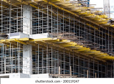 Building construction site detail with scaffolding and form work