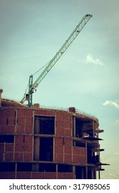 building construction site with large construction crane, image used old vintage style filter