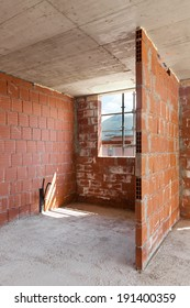 Building, construction site in progress to new house, brick wall