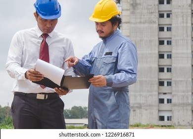 Building consultant. engineer and contractor discussing material specification from client in construction site area.