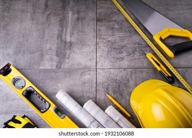 Building contractor. Construction symbols on gray tiles background.