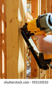 Building contractor worker putting in a interior wall partition nailer wall t