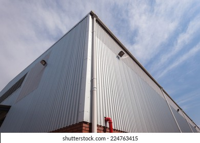 Building Corner Meat Sheeting Corner section of factory warehouse building built with metal  structure with  roofing cover sheeting and brick block walls