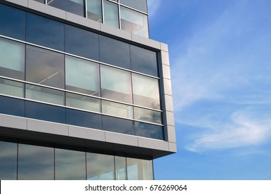 building corner skyscraper facade windows glass future finance architecture blue and white wall
