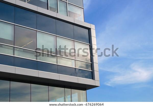 building corner skyscraper facade windows glass future finance architecture blue and white wall