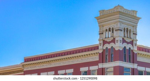 Building with corner tower in Provo against sky