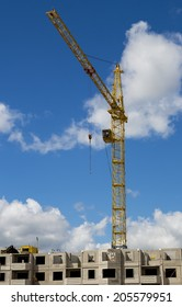 building crane on a background of building under construction