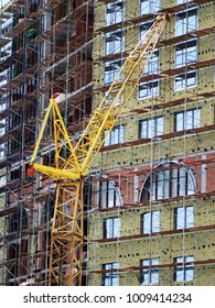 Building crane and building under construction, industrial