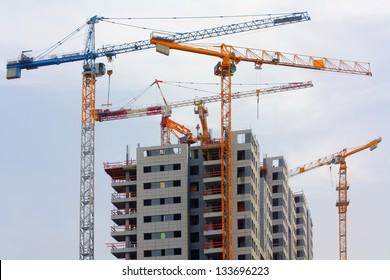 Building cranes and building house.israel.tel aviv