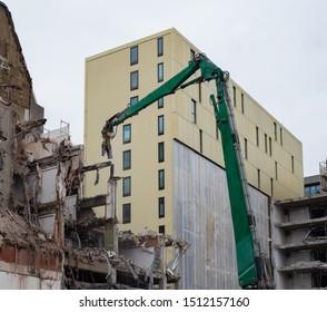 Building demolition with a demolition excavator on a building site
