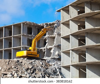Building demolition with hydraulic excavator