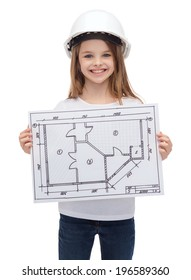 building, developing, construction and architecture concept - smiling little girl in white helmet showing blueprint