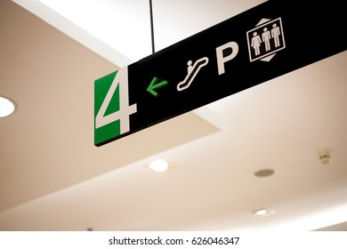 Building direction sign banner label arrow way to escalator car parking and lift elevator.