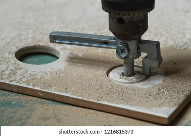 Building. Drilling holes in tile tile cutter.