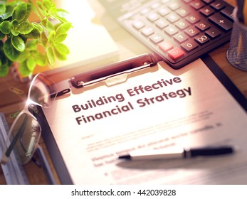 Building Effective Financial Strategy- Text on Paper Sheet on Clipboard and Stationery on Office Desk. 3d Rendering. Toned Image.