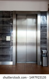 Building Elevator with closed door in apartment complex luxury silver