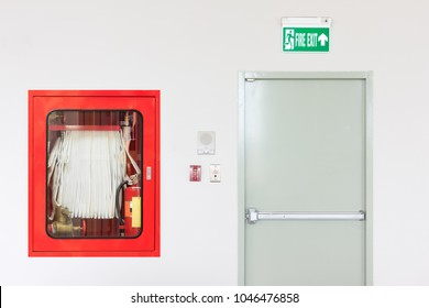 Building emergency exit with exit sign and fire extinguisher equipment.