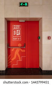 Building Emergency Exit with Exit Sign and Fire Extinguisher