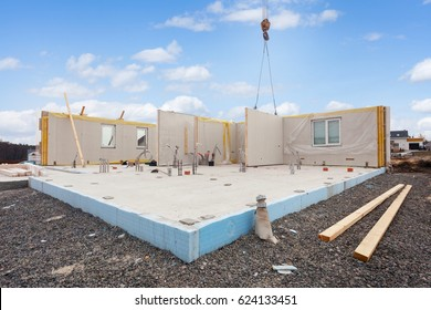Building the energy efficient house. Structural insulated panels with plastic tubes in foundation