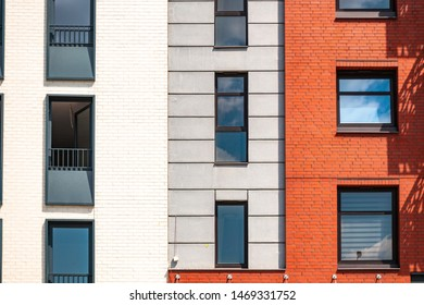 Building facade with architectural elements of red brick. Red brick detail in modern apartament building.