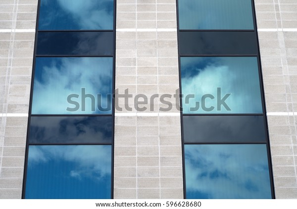 building facade architecture office business gray stone and glass wall