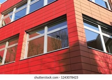 Building with facade cladding