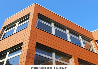 Building with facade cladding, close up