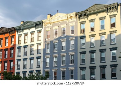 building facade, residential building on street, typical neighbourhood in USA.