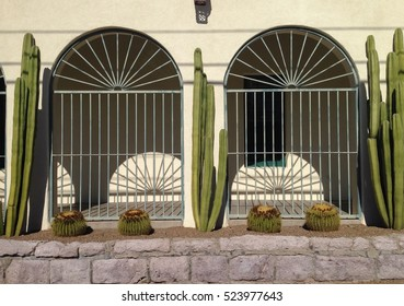 Building facade with wrought iron and cacti