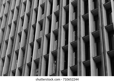 Building facades. Grid pattern. Architecture view. Black and white abstract building view. Background. Concrete structures.