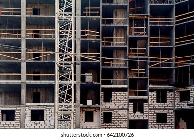 building frame of a panel house with concrete bricks for floors. Concept of building a house without walls.