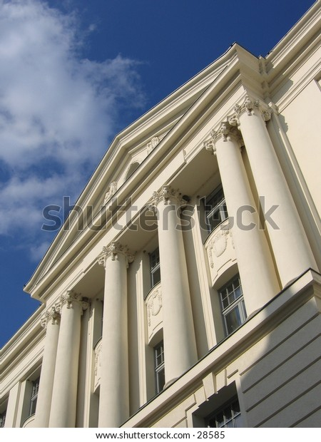 Building front with white columns.