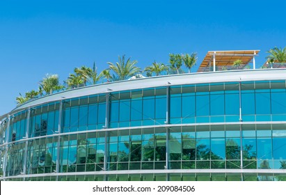 Building with a glass facade and green roof garden