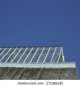 Building with glass roof and shingled wall
