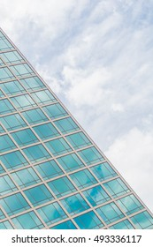 Building glass window pattern with a reflection of blue sky.