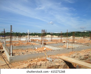 Building ground beam under construction. Made from steel reinforced concrete and the mold made from timber and plywood. Constructed by workers.