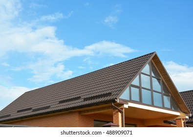 Building hew house with  beautiful roof windows, skylights. Roofing construction.