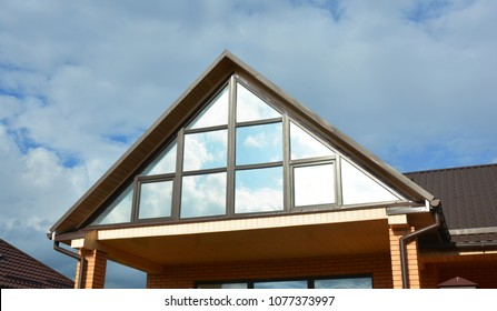 Building house attic conservatory terrace on the home roof with panoramic view. Conservatory or greenhouse roofing.