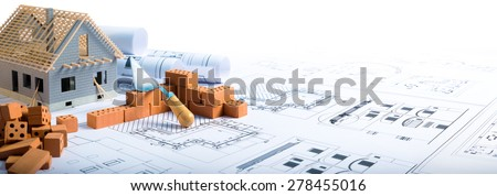 building house - brick and project for construction industry background