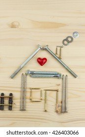 Building a house for the family. Plans to build a small house. Architect designing a house for a young family. House from nails and screws. Building a house.Building a house. Building a house.Building