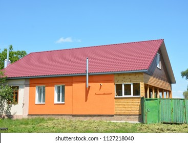 Building house with metal roof, steel gas chimney, wooden veranda, plastering and painting walls.