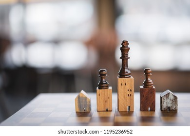 Building and house models in chess game, Business financial district and commercial , success and leadership business concept
