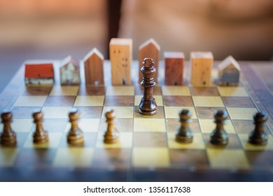 Building and house models in chess game, Business financial district and commercial , success and leadership business concept.
